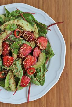 Strawberry salad with chili and toasted sesame seeds.