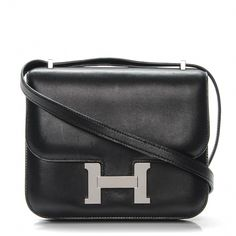 a31b76857131 This is an authentic HERMES Evercalf Constance 18 in Noir Black. This is a  chic
