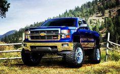 2014 Blue lifted Chevrolet Silverado truck