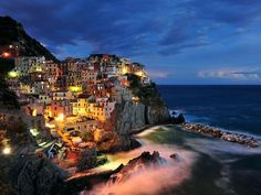The colourful cliff-side city of Manarola, Cinque Terre at night.