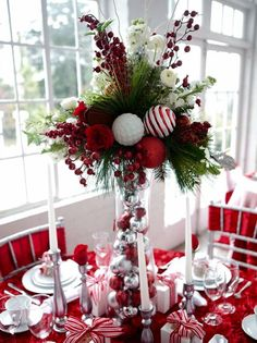 Christmas table setting. the center piece is high enough you can see everyone when you sit down. Z