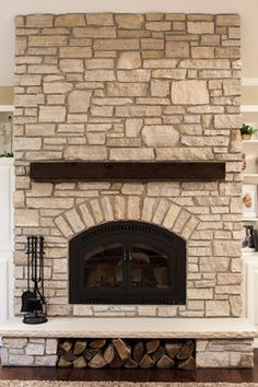 This is the most beautiful fireplace I have ever seen! Love the stone and rustic beam