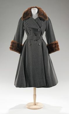 Coat, Designer: Norman Norell (American, Noblesville, Indiana 1900–1972 New York) Manufacturer: Traina-Norell (American, founded 1941) Date: ca. 1955 Culture: American Medium: wool, fur.
