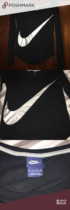NWOT! Black Nike long sleeve! 😍 New! Black long sleeve tee with silver shimmery swoosh. Scoopneck & slightly longer in back. Perfect condition!!! Nike Tops Tees - Long Sleeve