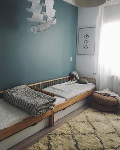 A shared room means having two beds. In a small space this can be tricky but with a little imagination, each child can have their own little space.