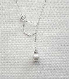 Great idea. Pearl Pendant Sterling Silver Necklace Lariat Necklace Swarovski Pearl Necklace Wedding Necklace Bridal Necklace via Etsy