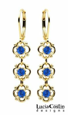 Lucia Costin Sterling Silver with 24K Yellow Gold Plated Dangle Earrings with 3 Lovely Flowers Surrounded by Dots and Blue Swarovski Crystals; Handmade in USA Lucia Costin. $36.00. Produced delicately by hand, made in USA. Delicate floral design. Unique and feminine, perfect to wear for special occasions and evenings. Lucia Costin dangle earrings. Enhanced with deep blue Swarovski crystals