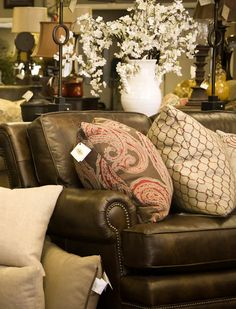 Leather sofa with patterned pillows.  noblehousedesign.com