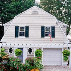 Painting garage doors the same color as your home's exterior cladding will help to lessen their visual impact from the street.