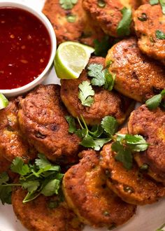 Close up photo of Thai Fish Cakes on a plate, ready to be eaten