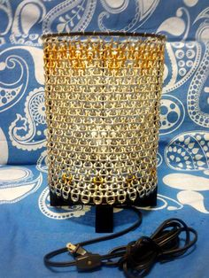 Pop tab lamp shield for second hand table lamp.