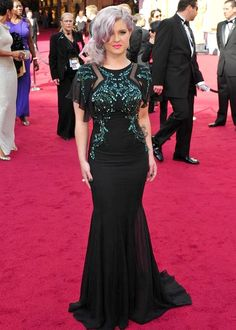 Kelly Osborne - Oscars 2012. I love the colors, don't like the mermaid style, and don't understand the gray hair.