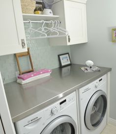 Laundry room - love the little rod to store spare hangers