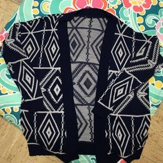 Navy and White Aztec print cardigan Navy and White Charlotte Russe cardigan. I absolutely love this cardi but just haven't worn it enough to justify keeping it. There's no signs of wear except the removed tag because it was uncomfortable. ❤️️make an offer❤️ Charlotte Russe Sweaters Cardigans