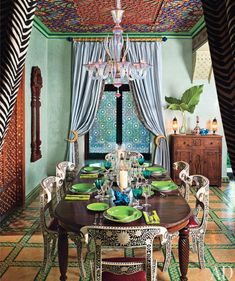 sooo frida~chic...hacienda dining... with a few exceptions...would change the table to an exquisite iron with a big old mex door for the top & the light fixture to iron also (and get rid of those crescent moon tie~backs)...realize this is supposed to be moroccan
