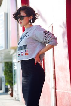 Nike sweatshirt with a Topshop pencil skirt, Balenciaga platforms, vintage rhinestone earrings, and Ray-ban sunglasses
