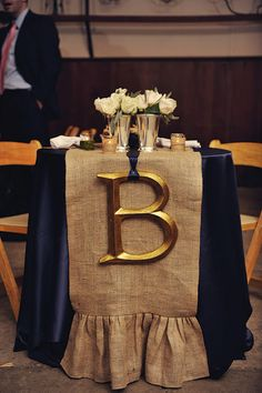 navy and burlap sweetheart table- Alyssia look at the burlap!  My sister-in-law made runners out of burlap for the rehearsal dinner. Looked great.