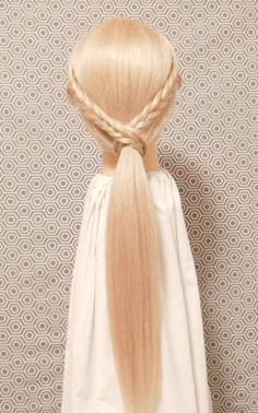 Upgrade your ponytail with two braids.