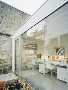 house in Sweden, designed by Elding Oscarson-- I love the open office idea, either open to outside or inside the house.