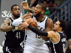 Nov. 7, 2015: Bucks center Greg Monroe (15) tries to work through a double-team by Nets defenders Thomas Robinson (41) and Shane Larkin (0) during the first half in Milwaukee. Monroe scored a team-high 20 points as the Bucks prevailed 94-86 and dealt the Nets their seventh straight loss to start the season.  Benny Sieu, USA TODAY Sports