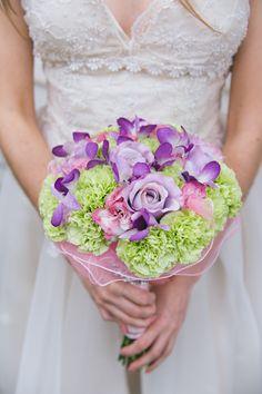 whimsical purple, green and pink wedding bouquet #colorfulbouquet #purplerose #carnations #weddingbouquet http://www.weddingchicks.com/2013/11/08/wizard-of-oz-wedding/