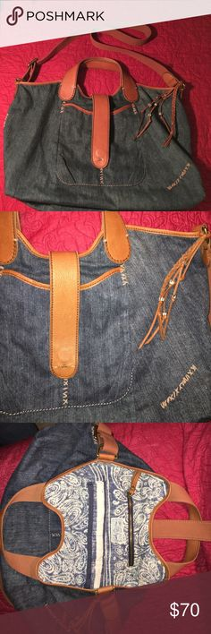 """LUCKY Brand denim tote Perfect condition!  Denim tote by Lucky Brand has both handles and adjustable shoulder strap, three pockets inside, one with zipper closure, pocket on the front of tote with magnetic leather strap closure.  Very cute lining.  14""""x22""""  ❌sorry no trades Lucky Brand Bags Totes"""