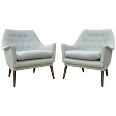 Stylish Pair of Mid Century Modern Sculpted Lounge Chairs in the manner of Gio Ponti | From a unique collection of antique and modern club chairs at https://www.1stdibs.com/furniture/seating/club-chairs/