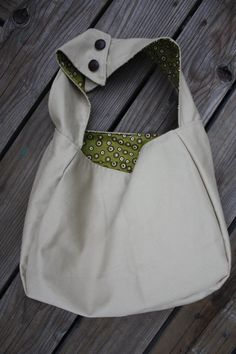 Medium Handmade Khaki Canvas Hobo Bag or Purse. $18.00, via Etsy.