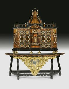 A Hispano-Flemish gilt-bronze-and gilt-metal-mounted ivory and tortoiseshell inlaid rosewood and ebonised parquetry and parcel-gilt cabinet on stand the cabinet and the top of the base mid 17th century.