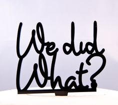 Wedding Cake Topper Wedding Decorations  Funny WE DID WHAT in script. $15.95, via Etsy.