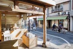 okomeya rice store by schemata enlivens tokyo shopping street Tokyo Shopping, Shopping Street, Rice Balls, Design Blogs, Interior Design Magazine, Retail Space, Store Displays, Store Design, Architecture Design
