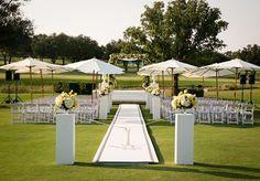 Chic outdoor wedding ceremony.... Umbrellas! great idea