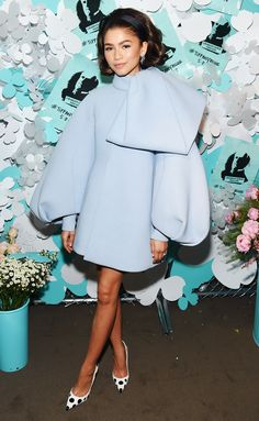 """wearing a baby blue dress with puffy sleeves and a large ribbon accent, paired with black-and-white polka dot pumps at the Tiffany & Co. """"Believe In Dreams"""" event in N.Y.C."""