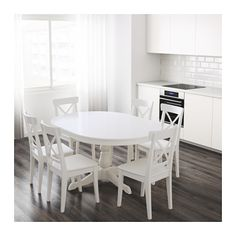 """Dining Table - Ikea - $350 - Changes from circle to oblong with leaves - 43"""" when cirlce"""