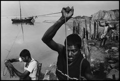 India 1993. Untouchables haul a boatload of sand up the   Ganges
