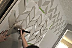 How to Paint a Wall using a Stencil {Herringbone Pattern}