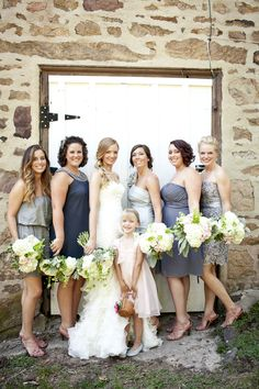 grey bridesmaid dresses all with pink shoes... A great way to include the pink. :)