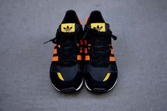 "Adidas ZX 700 ""Black/Orange"" sneaker just hit www.Karmaloop.com   Use repcode: ABUSE for 20% discount! #karmaloop #adidas"