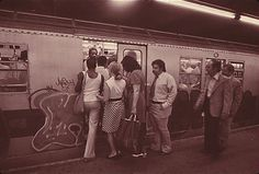 Passengers entering a Lexington Avenue subway car.