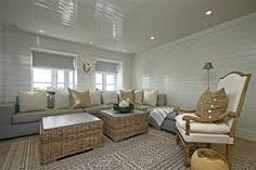 I love the horizontal tongue and groove wall panelling painted white in the loungeroom, then with a feature wall papered wall