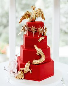 The Cake Studio of Ocean City decorated this geometric, four-tier chocolate tiramisu and green tea cake with a gold dragon and phoenix, which represent man and woman in the Chinese culture.