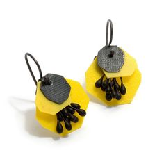 Yuko Fujita  Japanese born, Melbourne based jeweller Yuko Fujita has often made work that evokes and reinterprets natural forms. Here she delights with brightly coloured earrings made from polypropylene, paper and oxidised sterling silver. Yellow version.  $140