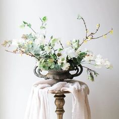 What a stunning floral display. Particularly love the vase and the strong architectural elements ・・・ Delicate beauty. Stunning arrangement by so beautifully balanced and captured perfectly by Wedding Table Centerpieces, Floral Centerpieces, Floral Arrangements, Wedding Decorations, Flower Arrangement, Centrepieces, Wedding Bouquets, Wedding Flowers, Silk And Willow