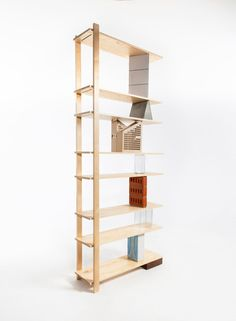 Stacking Objects To Hold Up Bookshelves by Emiel Remmelts