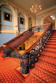 Neoclassic stair hall with wrought iron stair railings.