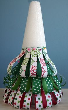 patterned paper, pins and a styrofoam tree Cute and easy Christmas decoration. Can totally be done using ribbon too