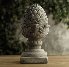 PINEAPPLE FINIAL  Welcome guests to the garden with this time-honored symbol of hospitality. Our cast-stone pineapple stands on a square base for placing on the ground or atop a pedestal.  Restoration Hardware