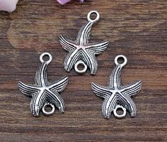 25pcs Starfish Charms Antique Tibetan Silver by DIYTreasureBox, $2.95 use these to tie on flip flops?