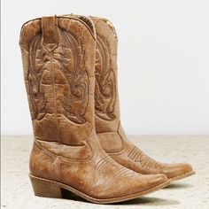 AE Stitched Cowboy Boots Tan cowboy boots from American Eagle Outfitters. Only worn a few times - in great condition! Not 100% I want to sell and am considering keeping, so no low ball offers please! I can't remember the size, but fit like a 9. American Eagle Outfitters Shoes Heeled Boots