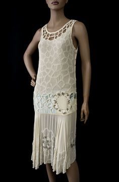 Beaded chiffon flapper dress, 1920s. Made from cream colored silk chiffon, the torso is embellished with a cobweb-style design of white glass beads.